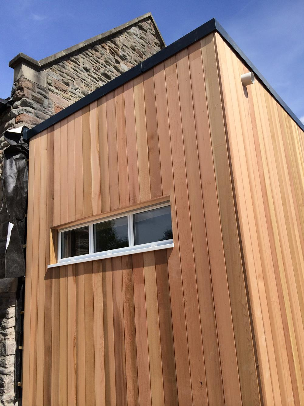 Building with Vertical Timber Cladding